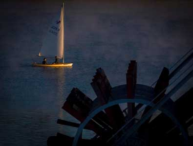 Tom and Willard sail the 2263 Banshee by the Mike Fink Restaurant at first light, photo by Michael Keating